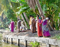 A Day of Shopping (1) (The Spirit of the World) Tags: shopping saris india kerala dock southernindia trees palmtrees lake shoreline colorful dailylife backwaters