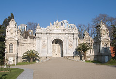 Dolmabache Palace Entrance - wide view (chrisdingsdale) Tags: ancient architecture asian bahche beautiful beauty blue bosphore castle clouds decoration design detail dolma door empire entrance europe gate islam istanbul kingdom landmark monument museum muslim nature old ornament outdoor palace palate red scenic site sky style sultan tourism tourist travel turkey turkish visit wall