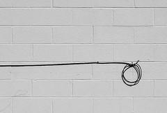 dekita (Wing Collar) Tags: cable cinderblock wall zen enso