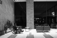 Alone in the Lobby - Chicago - 22 Aug 2016 - 5DS - 013 (Andre's Street Photography) Tags: chicago22aug20165ds lobby hospital northwestern downtown streeterville wheelchair paraplegic chicgo street straat straatfotografie streetphotography interior architecture blackandwhite bwphotogrphy candid urban desolation bleak abandoned metro medical center zwartwit blancoynegro noiretblanc
