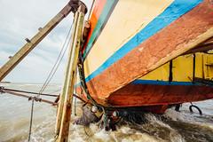Cleaning Underside of Fishing Boat, Bancar Indonesia (AdamCohn) Tags: adamcohn indonesia tuban tubanregency boat fishing fishingboat kapal kapalnelayan ship shipsboats wwwadamcohncom bancar