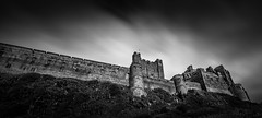 Bamburgh Castle (Daniel Zwierzchowski) Tags: bamburgh castle england uk outdoor monochrome black white blackandwhite bw bnw mountain architecture rocks canon eos550d eos t2i rebel 1022mm nd ndfilter