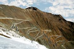 UMBRAIL MOUNTAIN PASS . . .  (SWITZERLAND, CRAUBUNDEN, INN, SANTA MARIA VAL MUSTAIR) (KAROLOS TRIVIZAS) Tags: switzerland craubunden inn santamariavalmustair umbrail road asphalt curves winding mountain peak summit rocks slopes clouds col pass scenicroad stones snow