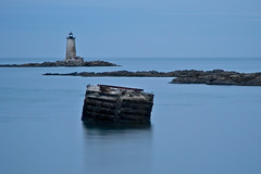 Solitude - in explore, front page (SunnyDazzled) Tags: ocean longexposure light sea lighthouse house seascape history tourism station evening coast lowlight scenery solitude maine ledge kittery whaleback fortfoster