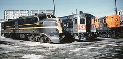 New Haven Railroad DER-1c ALCO DL-109 # 0750, Budd RDC-1 # 22 & DERS-3 FM H16-44 locomotive # 596, are seen spotted at the Charles Street Roundhouse in Providence, Rhode Island, during the mid 1950's, Mac Seabree Collection (alcomike43) Tags: old railroad color classic yard vintage ties 22 photo diesel tracks engine slide trains nh historic photograph maintenance budd rails service newhaven locomotive fm ballast providencerhodeisland rightofway dieselengine 750 alco railroadyard passengertrains roadbed diesellocomotive 596 rdc1 raildieselcar newhavenrailroad dieselelectriclocomotive nhrr dl109 h1644 convnetionaljointedsectionrail der1c ders3 charlesstreetroundhouse
