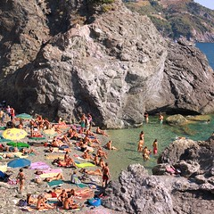 Family friendly atmosphere at the rocky beach of Levanto (Bn) Tags: travel family blue sea summer vacation italy baby holiday hot beach water colors sunshine swimming magazine children fun coast seaside italian sand rocks mediterranean italia day afternoon locals play liguria families joy group relaxing traditions down tourist tourists line resort busy delight parasol grandparents towels cinqueterre bathing activity lying popular quaint sunbathing pleasure adriatic sunbather crowded cooling levanto booking jammed sunbeds overrun
