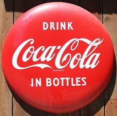 Coke in bottles... (Slider Jake) Tags: sign coke squircle cokebottles coca~cola