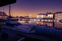 bathed in sunset hues, Vieux Bassin, Quai St Etienne, carousel & ferris wheel, Honfleur, Normandie, France (grumpybaldprof) Tags: vieuxbassin oldharbour honfleur normandie normandy france quaistecatherine quaiquarantaine quai quaistetienne stecatherine lalieutenance quarantaine water boats sails ships harbour historic old ancient monument picturesque restaurants bars town port colour bw lights reflection architecture buildings mooring sailing stone collombage halftimbered yachts oldport tourist ferriswheel carousel merrygoround reflections colours sunset motorboat launch elegance awning umbrella marina marine dock