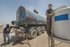 Hardship in the Desert_190 (EU Humanitarian Aid and Civil Protection) Tags: iraq fallujah anbar water nrc norwegianrefugeecouncil children desert tank boy tanker truck
