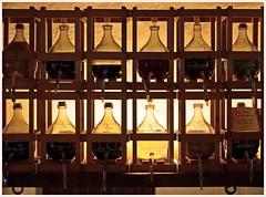 Alchemy... (kurtwolf303) Tags: flaschen bottles regal shelf olympusem1 omd microfourthirds micro43 systemcamera unlimitedphotos topf25 250v10f topf50 500v20f topf75 topf100 900views 1000v40f