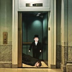 Master & Servant (Flamenco Sun) Tags: hotel lobby murder bizarre disturbing horror weird ventriloquist dummy funny elevator lift
