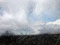 Rain on my Windshield - Late Feb. 2005 (Charlotte Clarke Geier) Tags: storm clouds rainbow desert storms