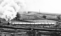 Lizzie storming up Shap with The Cumbrian Mountaineer (Andrew Edkins) Tags: uk november trees winter england blackandwhite cold heritage monochrome wall train geotagged motorway pacific smoke sony border railway lizzie passengers cumbria concorde aviary railtour effect m6 steamtrain 2012 incline carriages lms clag storming shap overheadwires northofengland westcoastmainline wcml stanier 6201 princesselizabeth 8p 46201 vintagetrains mainlinesteam shapwells 1z90 thecumbrianmountaineer steamupshap videoimagestill 1in75