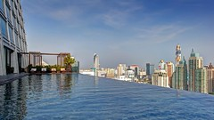 Infinity Edge Pool over Bangkok (Day) (I Prahin | www.southeastasia-images.com) Tags: food tower window glass architecture modern bar skyscraper thailand restaurant hotel design day exterior view chairs bangkok steel interior landmark swimmingpool tables dining fusion luxury 5star bts ploenchit chidlom okurahotel infinityedge ecoplex exposurefusion okuraprestige okurainternational ploenjit parkventures parkchidlom pwpartlycloudy