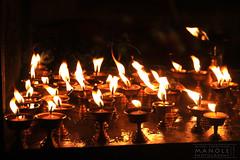 Sacred Light (Mihai Sebastian Manole) Tags: nepal light orange color yellow canon temple fire candles tibetan kathmandu lumina thamel 1635mm lumanari templu