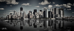 Manhattan Skyline (bgspix) Tags: city nyc bw usa ny newyork reflection brooklyn america canon us blackwhite cityscape manhattan reflect eastriver bigapple lowermanhattan desaturate skycrapper skylie eos60d ef70200mmf28lisiiusm