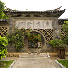 Circular Doorway At Zhu Family House, Jianshui, Yunnan Province, China (Eric Lafforgue) Tags: china old people house abstract color colour history wall architecture garden circle square outdoors person photography asia day outdoor nopeople carving doorway  ornate yunnan 2people twopeople kina chin cina chine buildingfront xina traditionalculture  eastasia  chineseculture jianshui realpeople tiongkok  traveldestinations colorimage chiny  kna in buildingexterior twopersons colorpicture yunnanprovince colourimage   trungquc residentialstructure na   kitajska tsina      traditionallychinese  circulardoorway a0006059