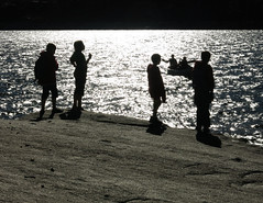 Arrival On The Alien Shore (ShutterSherpa) Tags: granite beach boyscouts scouts camping canoes silhouette blackwhite adventure canong15 lake water shore canon canonpowershotg15