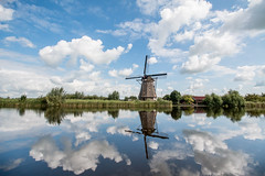 Kinderdijk, Netherlands (Brady Withers) Tags: kinderdijk netherlands bwsterlingphotography bradywithersphotography sky reflection windmill rhine river beautiful clouds peaceful