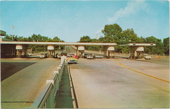 SE Port Huron MI 1950s GREAT CARS at TOLL BOOTHS & US CUSTOMS The Blue Water Bridge is a twin-span international bridge across the St. Clair River that links Port Huron to Sarnia Canada 1 (UpNorth Memories - Donald (Don) Harrison) Tags:  railroad ferry car excursion vintage antique postcard rppc don harrison upnorth memories upnorth memories upnorthmemories michigan history heritage travel tourism michigan roadside restaurants cafes motels hotels tourist stops travel trailer parks campgrounds cottages cabins roadside entertainment natural wonders attractions usa puremichigan