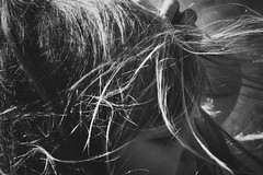 It's windy out (jean_pichot1) Tags: shadow close closeup walking bw hand eyes face girl gust sunshine highlights hair wind