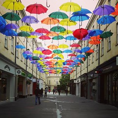 179/366 - Bath (ready for a shower) (Spannarama) Tags: 366 june umbrellas brollies colourful overhead hanging street bath uk square