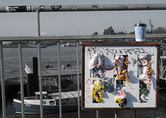 give-and-take... (Soenke HH) Tags: gumballmachine bw selectivecolors pov fun harbour hamburg landungsbrcken hafen kaugummi kaugummiautomat abfall mll rubbish mulleimer situation boat ruth coffee arabica schwarzweiss farben muted spass absurd kran himmel aufkleber sticker bank people olympusstylus1 olympus stylus1