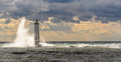 Pier Energy (Aaron Springer) Tags: michigan northernmichigan lakemichigan thegreatlakes frankfortmichigan frankfortlighthouse storm stormlight breakwater pier clouds sunlit illuminated september nautical maritime lighthouse breakingwave outdoor nature landscape