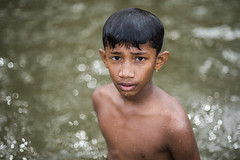 At Uttamapalaiyam (Ravikanth K) Tags: 500px boy portrait portraiture water bokeh wet bathing uttamapalaiyam tamilnadu india kid hair drops nikon85mm nikond750 uthamapalayam river mullai periyar look outdoor people travel