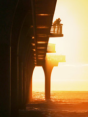 The Golden Light (Steve Taylor (Photography)) Tags: orange photographer aa travel competition top10 silhouette pier sun rays beams sol christchurch newbrighton canterbury newzealand nz gold golden underneath underside jetty light dawn sunrise sunup camera couple digitalcameraclub stevetaylor
