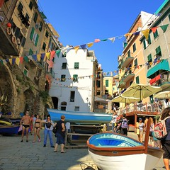 Relaxing summer afternoon in Riomaggiore (Bn) Tags: world ocean park flowers blue houses sunset sea summer vacation sky orange sun sunlight moon holiday flower tower heritage classic water colors beautiful weather night buildings walking boats coast boat high fishing topf50 warm mediterranean italia sailing ship torre gulf view hiking path five liguria shoreline hike case cliffs lovers quay historic unesco via anchovies national wharf terre sail botanic mountainside quaint viewpoint picturesque coloured cinque adriatic riomaggiore italianriviera torri dellamore 50faves guardiolas