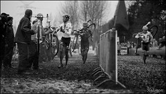 Sven Nys (BE) & Niels Albert (BE) battle it out in the pits while Bart Wellens tries to overtake them on the course (kristof ramon) Tags: men pits mud belgium cx cyclocross worldchampion golazo bkcppowerplus telenetfidea kramonbe eliteman bartwellensbe svennysbe nielsalbertbe soudalclassics jaarmarktcrossniel2012