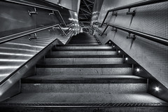 Stars and Stripes (Daniel Borg) Tags: camera city england blackandwhite bw white black london lines architecture stairs buildings reflections underground stars lights vanishingpoint unitedkingdom pov stripes empty tube wideangle trainstation tubestation londonunderground kingscross canon1022 danielborg londontrainstation canon550d cityandarchitecture