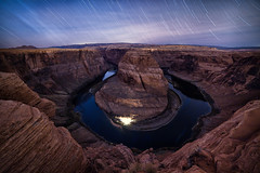 Horseshoe under the stars (posthumus_cake (www.pinnaclephotography.net)) Tags: longexposure november autumn arizona cliff usa southwest fall nature water night canon river dark stars landscape twilight outdoor 14 vertigo az explore nighttime page 5d horseshoe bluehour wilderness heights startrails starlight starscape horseshoebend pageaz 14mm samyang14mm samyang14mmf28ifedmcaspherical