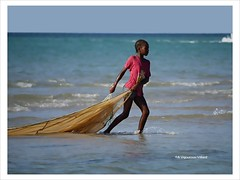 A la pche (a.vigourouxvillard (Back from Tenerife)) Tags: ocean voyage travel blue woman beach nature colors eau couleurs femme bleu madagascar plage couleur colorphotoaward flickraward panoramafotogrfico panasonicdmcg1 thebestofmimamorsgroups natureandpeopleinnature mygearandme mygearandmepremium mygearandmebronze mygearandmesilver