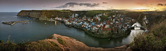 As the sun goes down on Staithes (YorkshireSam) Tags: sunset sea england panorama sunlight water reflections landscape boats evening coast seaside nikon scenery village harbour yorkshire north cliffs coastal whitby northyorkshire cottages staithes coble boulby northeastofengland samsalt yorkshiresam