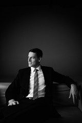 Sebastian #II (Alexander Rentsch) Tags: portrait white black male monochrome face studio grey gesicht shadows tie couch suit sight lowkey schatten blick canonef2470mmf28lusm gentleman elegance krawatte anzug mnnlich eleganz canoneos5dmarkii