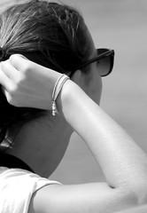 Sun glasses (patrick_milan) Tags: noiretblanc blackandwhite noir blanc monochrome nb bw black white street rue people personne gens streetview fminin femal femme woman women girl fille belle beautiful portrait face candide