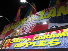 Candy Land Food Trailer. (dccradio) Tags: malone ny newyork franklincounty franklincountyfair communityevent fun entertainment event annual fair festival countyfair night lights amusementsofamerica biga aofa carnival midway candyland sign popper candyapples caramelapples flags foodtrailer concessions concessiontrailer fairfood popcorn snokones cottoncandy