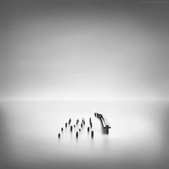 Nineteen / ONE. Pier structure near Hatteras, North Carolina, USA 2016. (Thibault Roland) Tags: thibaultroland roland wwwthibaultrolandcom sony a7rii sonya7rii us usa unitedstates unitedstatesofamerica landscapephotographer seascapephotographer landscapephotography blackandwhite landscape bw fineart fineartphotographer fineartphotography image le longexposure monochrome photo photograph photographer photography clouds cloud nuages expositionlongue longueexposition 16stops tilt shift tiltshift beach ocean sea formatthitech firecrest jetty pier poles sticks minimalism minimalistic sonyartisansofimagery sonyartisanofimagery globalimagingambassador globalimagingambassadors sonyaoi saoi sgia manfrotto nc northcarolina hatteras