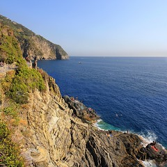 Stairs of Via dell'Amore lead down to sunbathing rocks of Cinque Terre (Bn) Tags: world ocean park pink flowers blue houses sea summer vacation sky orange sun sunlight holiday flower tower heritage water colors beautiful weather train buildings walking coast boat high topf50 warm mediterranean italia day torre hiking path five character liguria hike case cliffs lovers quay historic unesco via clear vineyards national wharf terre botanic mountainside overlooking quaint inspire incredible viewpoint picturesque coloured trial cinque adriatic riomaggiore italianriviera torri yellew dellamore 50faves guardiolas