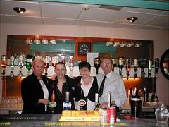 Bangor.- Gloria & Staff in Royal Naval Club, Bangor, County Down in Northern Ireland. (mrvisk) Tags: old november irish history bar pub drink 2006 guinness spirits harp navel