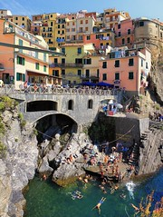 Adventures at Manarola's local swimming hole (Bn) Tags: world ocean park pink flowers blue trees houses sea vacation sky orange sunlight flower tower heritage church water colors beautiful weather saint train buildings coast boat topf50 warm mediterranean italia sailing ship torre gulf hiking path five character liguria shoreline hike case cliffs quay historic bougainvillea unesco via vineyards national wharf terre sail mountainside overlooking quaint inspire incredible viewpoint picturesque coloured manarola cinque giovanni italians italianriviera torri confraternita battista dellamore 50faves guardiolas