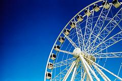 Wheel of Excellence (SNAPKAMERA) Tags: blue film wheel town lomography waterfront pentax k1000 ferris cape