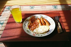 mju - sausage, bacon and egg (johnnytakespictures) Tags: food film breakfast dinner lunch bacon mju kodak egg sausage plate olympus meal automatic analogue fried eatingout mju1 ultramax400