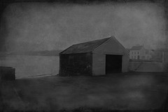 Cold Comfort (sbox) Tags: ireland sea blackandwhite bw texture buildings fishing harbour shed oldbuildings wharf countydonegal moville inishowen