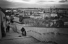 Street musician (Aelitha) Tags: street musician monochrome wall skyline canon blackwhite europe cityscape prague guitar czechrepublic vignette cityview praguecastle malastrana canonef24mmf28 artinbw
