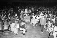 Santa entering Christmas party, 1954 (Seattle Municipal Archives) Tags: seattle santa christmas 1950s ponies clowns christmasparties sleighs seattlemunicipalarchives