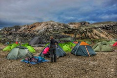 Iceland ~ Landmannalaugar Route ~  Ultramarathon is held on the route each July ~ Camp Site (Onasill ~ Bill Badzo) Tags: iceland landmannalaugar route trail hiking snow mountain nature sky clouds onasill landmark historic hdr mountains july camp site tents landscape reykjavk ultramannalaugar