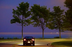 Lakeshore Drive (imageClear) Tags: lakeshoredrive lakeshore sheboygan wisconsin nikon aperture evening night lights lake lakemichigan handheld d600 80400mm beauty trees car road imageclear flickr photostream